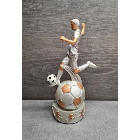 trophée footballeur en action